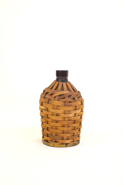 large wicker covered bottle
