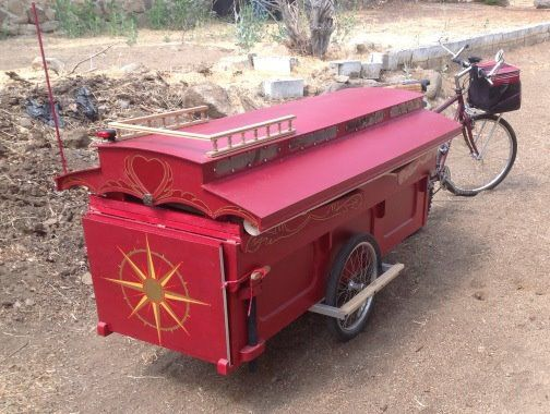 gypsy caravan howard 11 - Artist built a micro gypsy wagon you can tow with your bike
