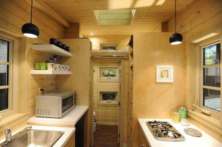 the dragonfly tiny house boasts unique pullout stairs