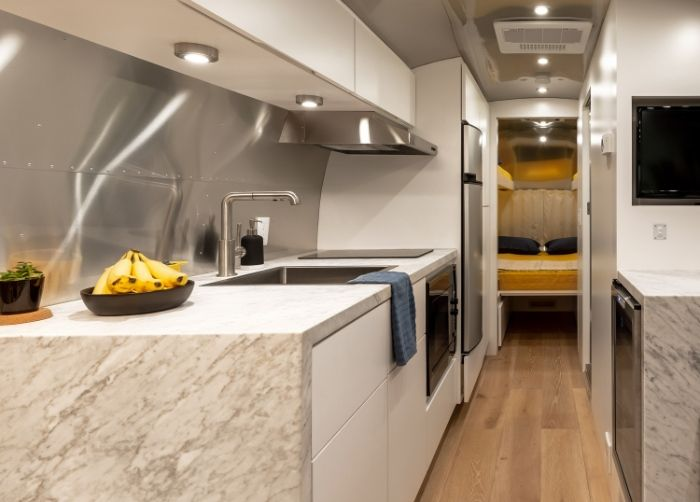 Contemporary City Airstream Motorhome by Timeless Travel Trailers 1 3 - Customized Airstream camper fits seven with room to spare for pop-up bar and entertainment area