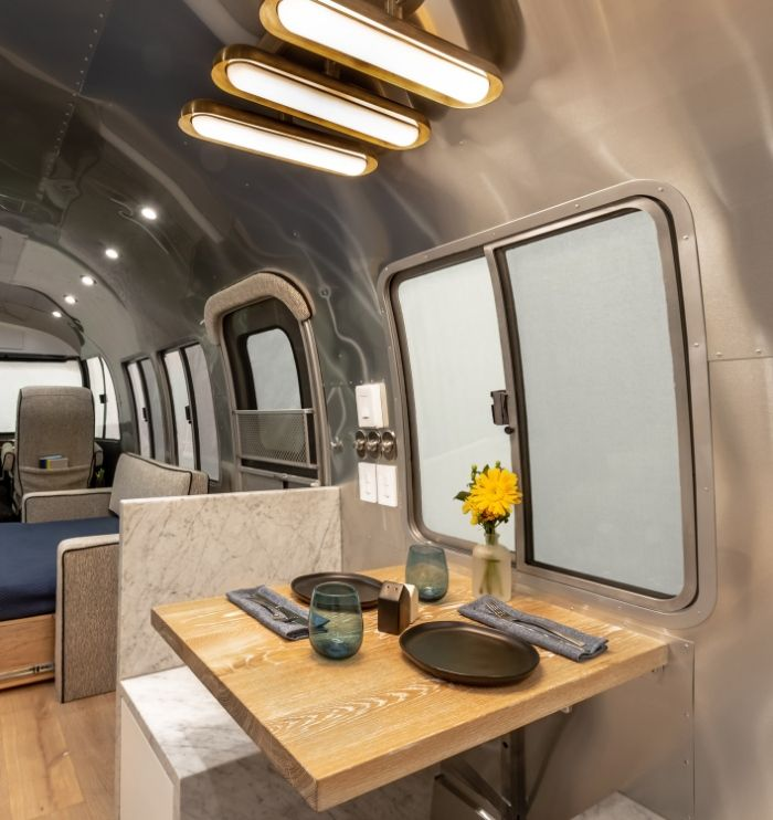 Contemporary City Airstream Motorhome by Timeless Travel Trailers 1 5 - Customized Airstream camper fits seven with room to spare for pop-up bar and entertainment area