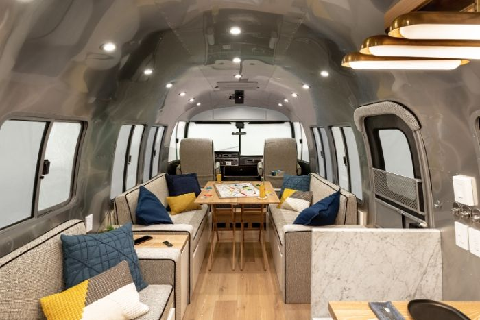 Contemporary City Airstream Motorhome by Timeless Travel Trailers 1 6 - Customized Airstream camper fits seven with room to spare for pop-up bar and entertainment area