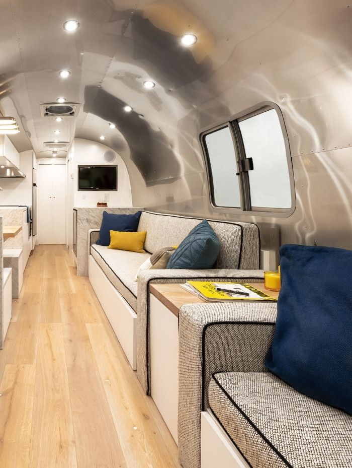Contemporary City Airstream Motorhome by Timeless Travel Trailers 1 7 - Customized Airstream camper fits seven with room to spare for pop-up bar and entertainment area