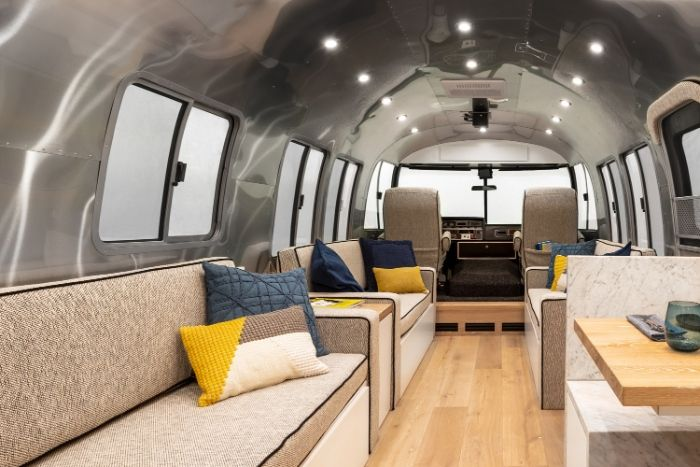 Contemporary City Airstream Motorhome by Timeless Travel Trailers 1 8 - Customized Airstream camper fits seven with room to spare for pop-up bar and entertainment area
