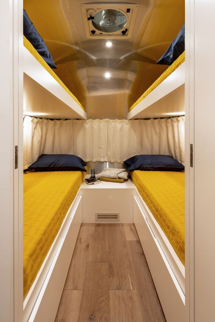 Contemporary City Airstream Motorhome by Timeless Travel Trailers 20 - Customized Airstream camper fits seven with room to spare for pop-up bar and entertainment area