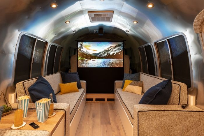 Contemporary City Airstream Motorhome by Timeless Travel Trailers 4 - Customized Airstream camper fits seven with room to spare for pop-up bar and entertainment area