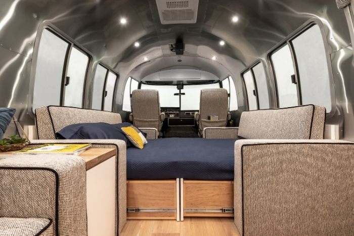 Contemporary City Airstream Motorhome by Timeless Travel Trailers3 - Customized Airstream camper fits seven with room to spare for pop-up bar and entertainment area