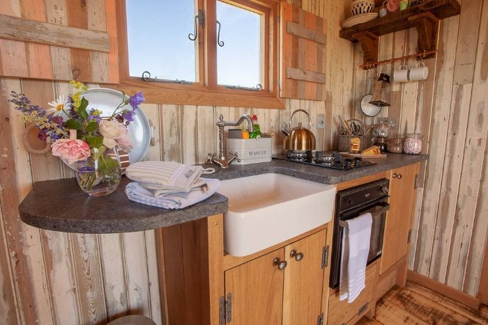 fully equipped kitchen inside dunmore at huts in the hills 1024 wide - Charming shepherd's hut boasts an ingenious bed with built-in dining table