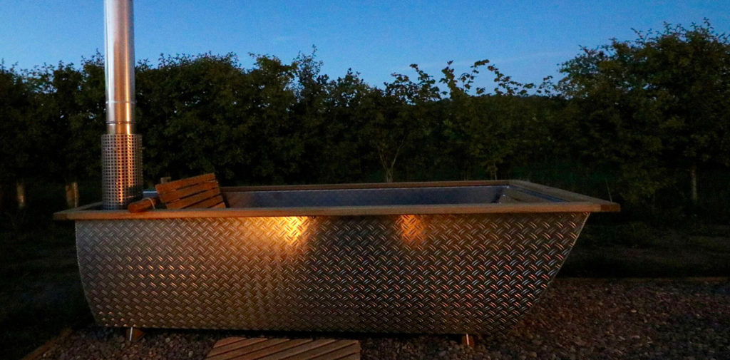 hot tub slider 1024x505 - This modern wooden igloo hut boasts a cozy alcove bed and an eclectic Scandinavian style