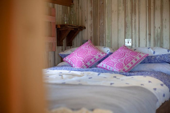 king size bed inside dunmore at huts in the hills in northumberland 1024 wide 1 - Charming shepherd's hut boasts an ingenious bed with built-in dining table