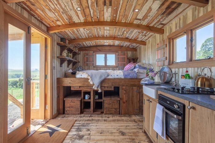 king size bed inside dunmore at huts in the hills in northumberland 1024 wide - Charming shepherd's hut boasts an ingenious bed with built-in dining table