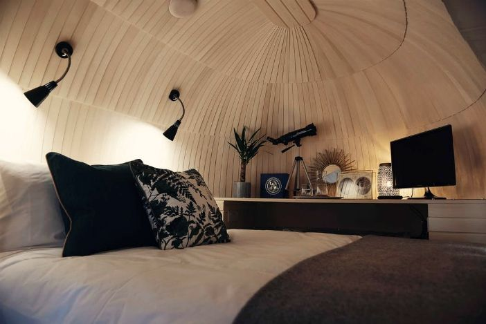 wc - This modern wooden igloo hut boasts a cozy alcove bed and an eclectic Scandinavian style