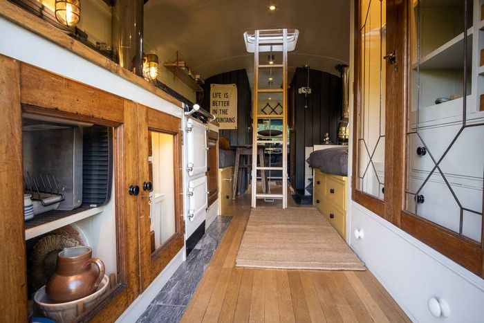 fully equipped kitchen inside the converted bus at hinterlandes in a remote corner of the lake district 1024 wide 1 - Glamp out in a converted bus with a VW camper bedroom on the roof