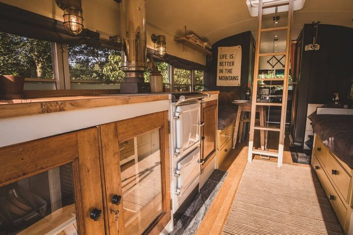 fully equipped kitchen inside the converted bus at hinterlandes in a remote corner of the lake district 1024 wide - Glamp out in a converted bus with a VW camper bedroom on the roof