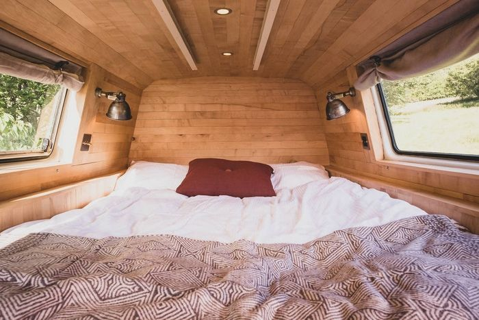 one double bed inside hinterlandes the converted bus in a remote corner of the lake district 1024 wide - Glamp out in a converted bus with a VW camper bedroom on the roof