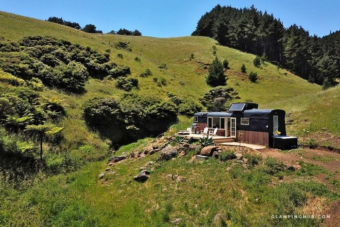 Romantic Glamping Getaway with Ocean Views and an Outdoor Bath in Raglan North Island 6 - Try out tiny house living in these 18 beautiful holiday homes