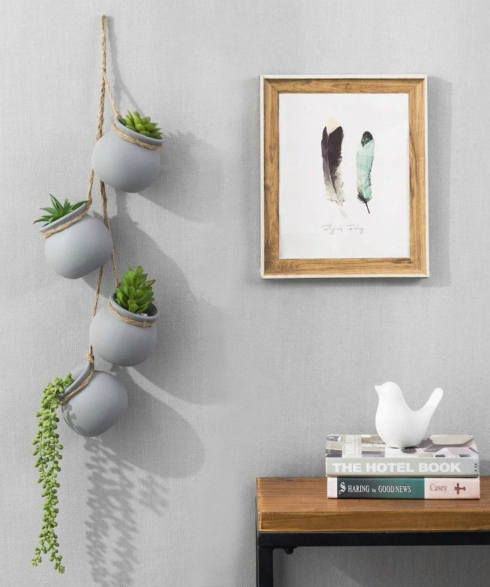 Contemporary Hanging Gray Ceramic Mini Planter Pots with Jute Rope - 20 stylish ideas for decorating your small space with plants