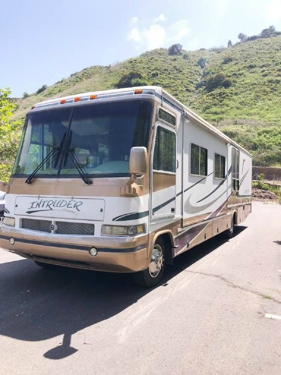 damon bus - Young couple turned drab motorhome into white haven (and cut their living expenses in half)
