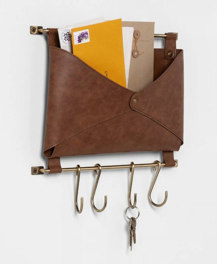 letter faux leather wall storage 1 - Add storage to any room with these 20 excellent wall organizers