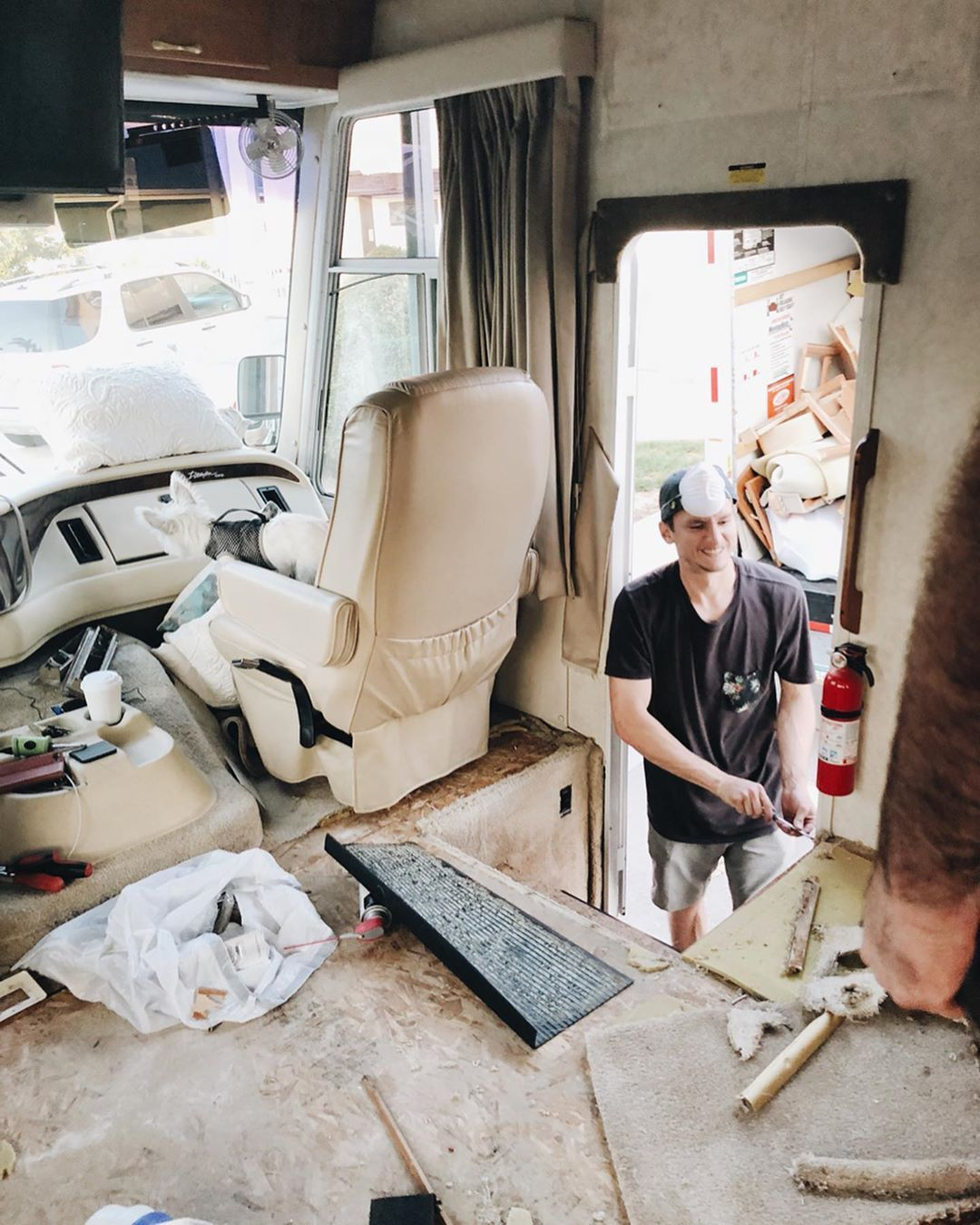 motorhome - Young couple turned drab motorhome into white haven (and cut their living expenses in half)