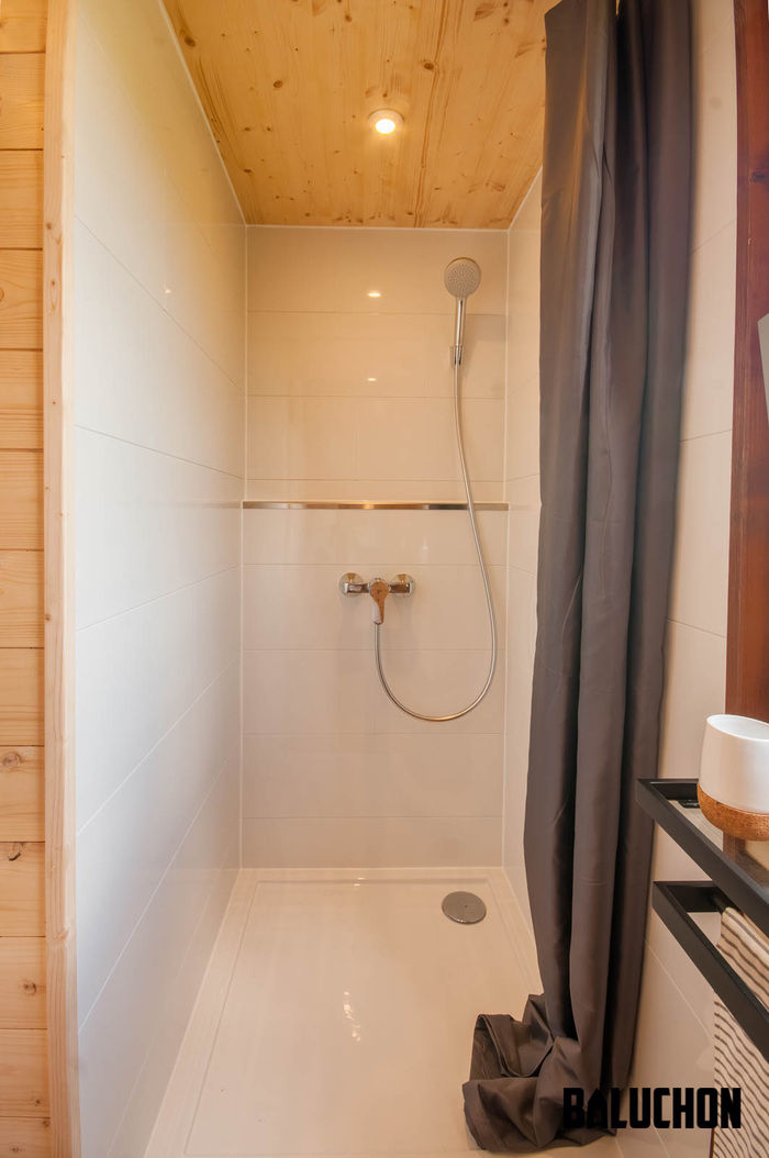 pampille tiny house 10 - The loft bedroom in this tiny house can easily be divided into two rooms