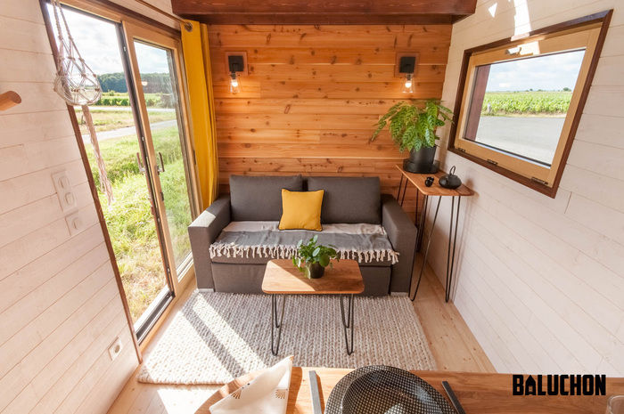 pampille tiny house 6 - The loft bedroom in this tiny house can easily be divided into two rooms