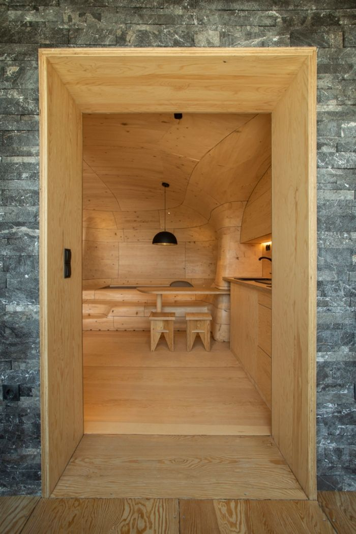 wood cave holiday home 1 - Tenon Architecture creates spectacular wooden cave for Greek resort