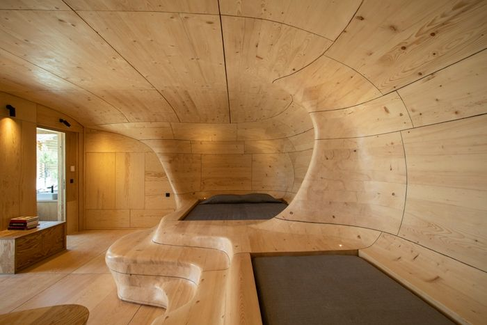 wood cave holiday home 2 - Tenon Architecture creates spectacular wooden cave for Greek resort