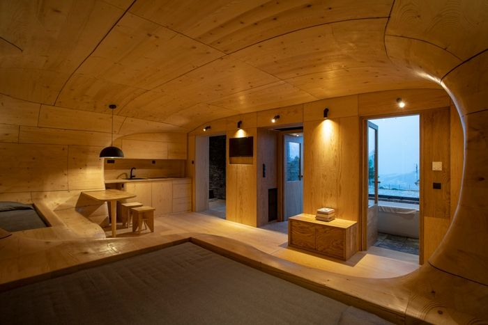 wood cave holiday home 3 - Tenon Architecture creates spectacular wooden cave for Greek resort