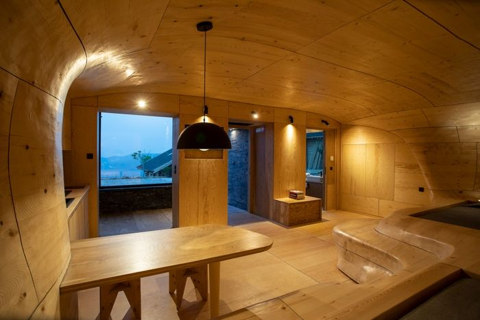 wood cave holiday home 4 - Tenon Architecture creates spectacular wooden cave for Greek resort