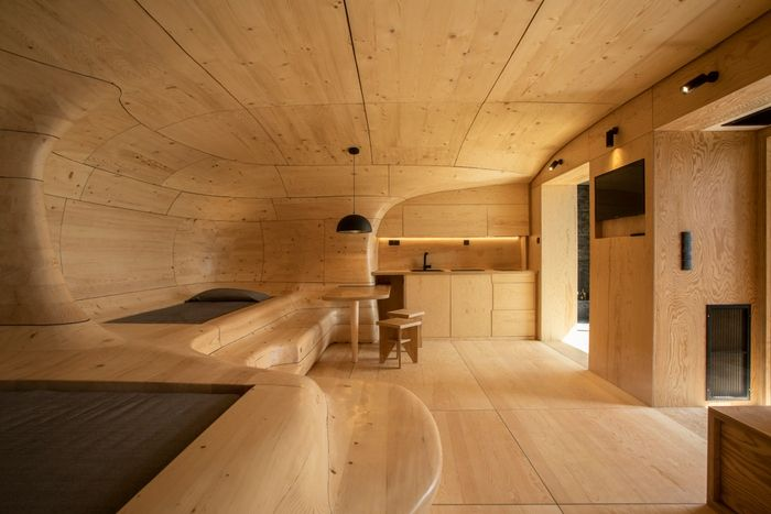 wood cave holiday home 8 - Tenon Architecture creates spectacular wooden cave for Greek resort