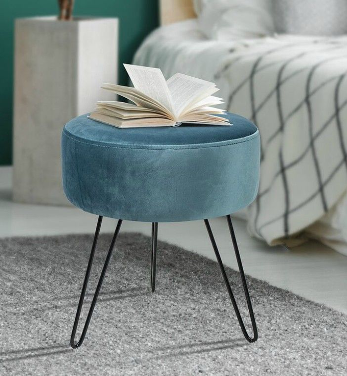 VelvetRoundOttoman - 20 poufs and ottomans that add some wow-factor to your home