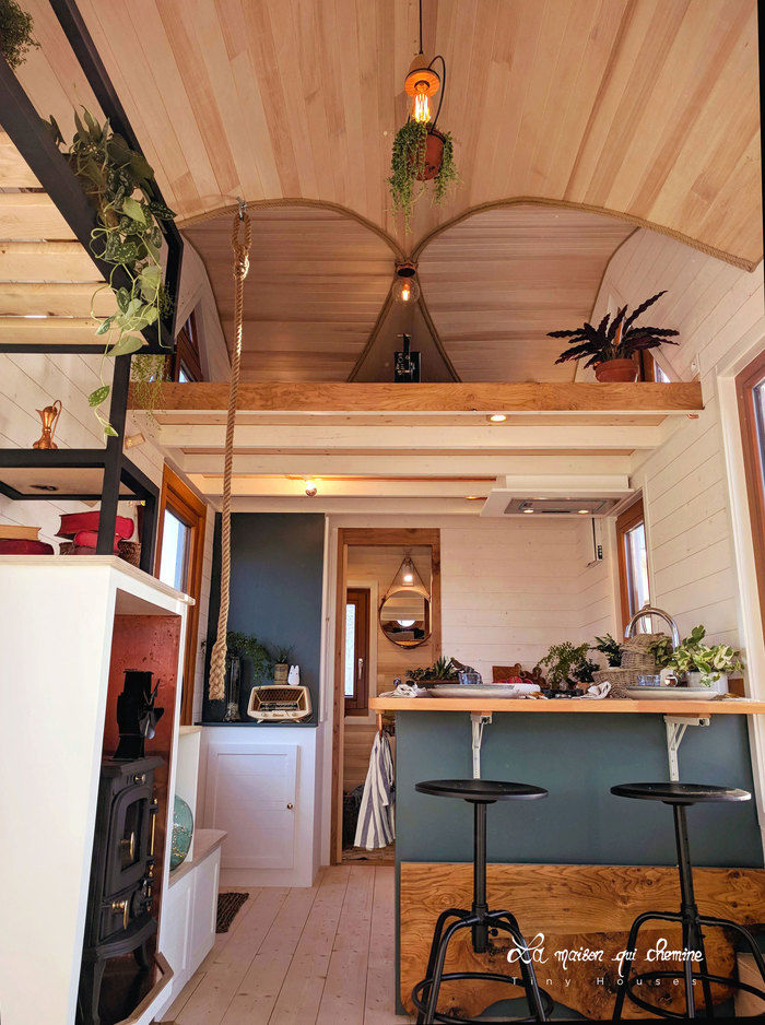 la flore tiny house 1 - Cottage feel tiny house boasts a creative staircase that leads up to two lofts
