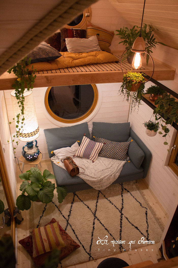 la flore tiny house 7 - Cottage feel tiny house boasts a creative staircase that leads up to two lofts