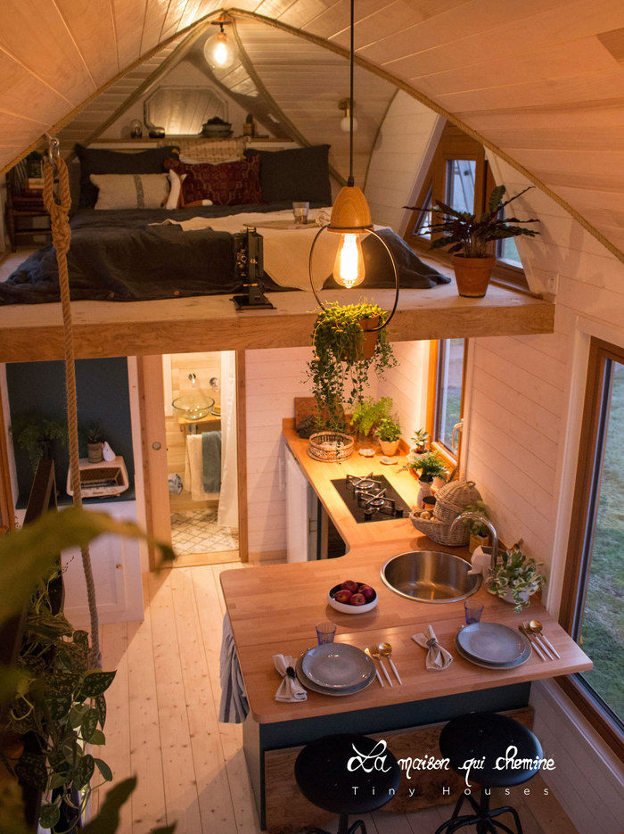 la flore tiny house 9 - Cottage feel tiny house boasts a creative staircase that leads up to two lofts