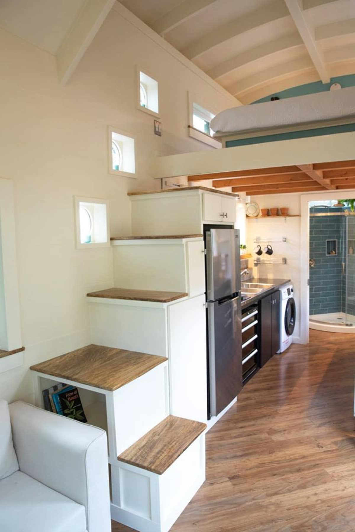 oasis tiny house 13 - Hawaiian tiny house is stacked with space-saving solutions including a shower jutting out over the trailer's tongue