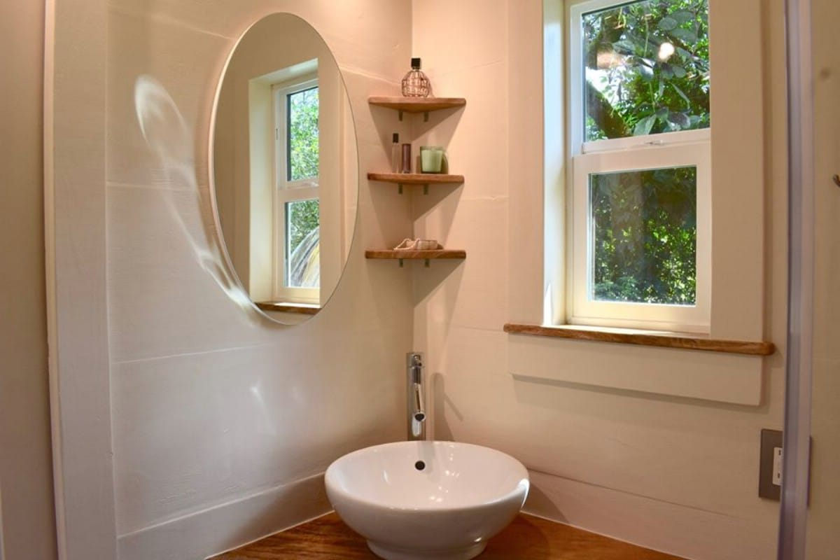 oasis tiny house 15 - Hawaiian tiny house is stacked with space-saving solutions including a shower jutting out over the trailer's tongue