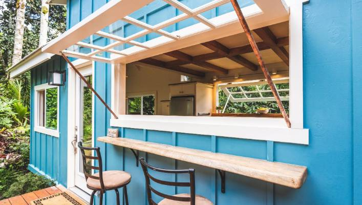 oasis tiny house 6 - Hawaiian tiny house is stacked with space-saving solutions including a shower jutting out over the trailer's tongue