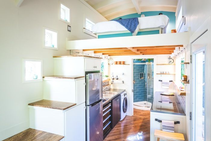 tiny house oasis 20 - Hawaiian tiny house is stacked with space-saving solutions including a shower jutting out over the trailer's tongue