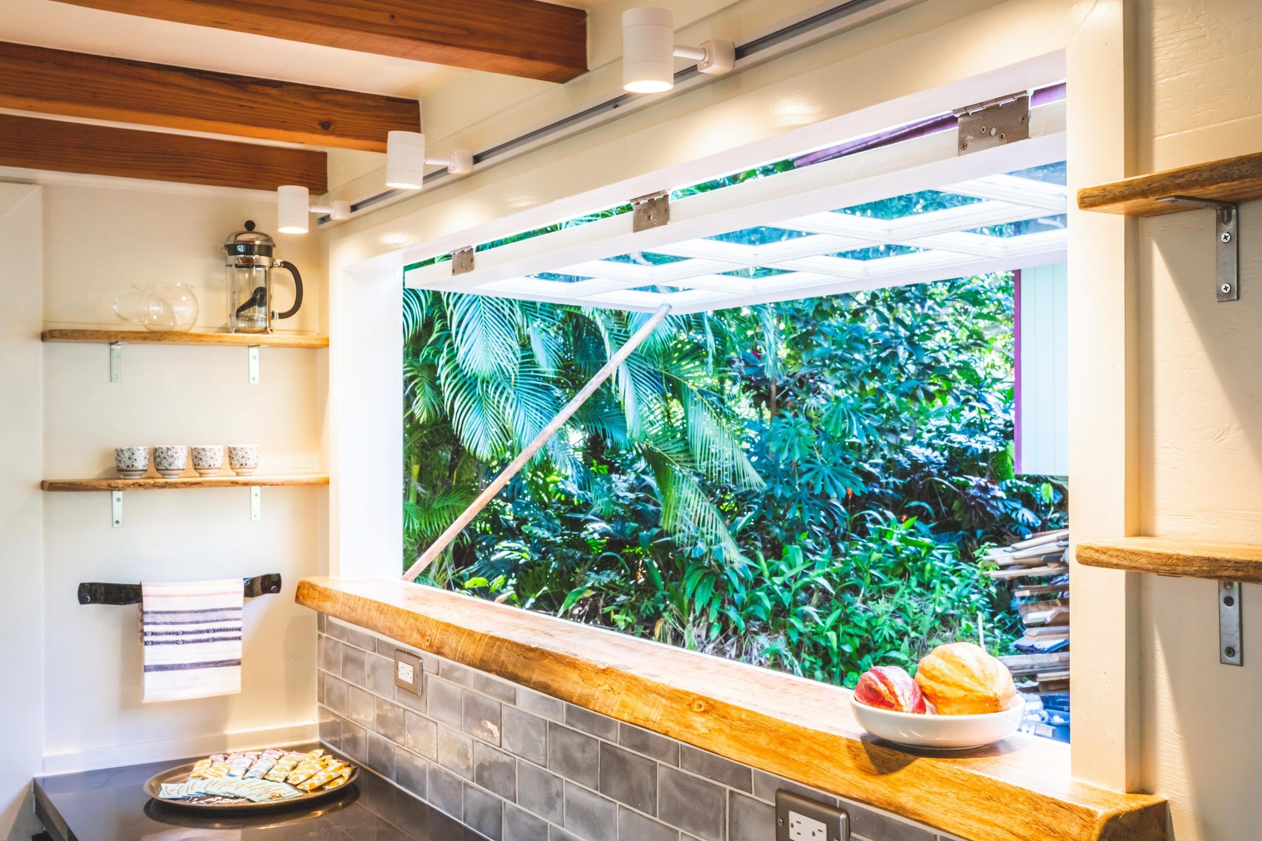 tiny house oasis scaled - Hawaiian tiny house is stacked with space-saving solutions including a shower jutting out over the trailer's tongue