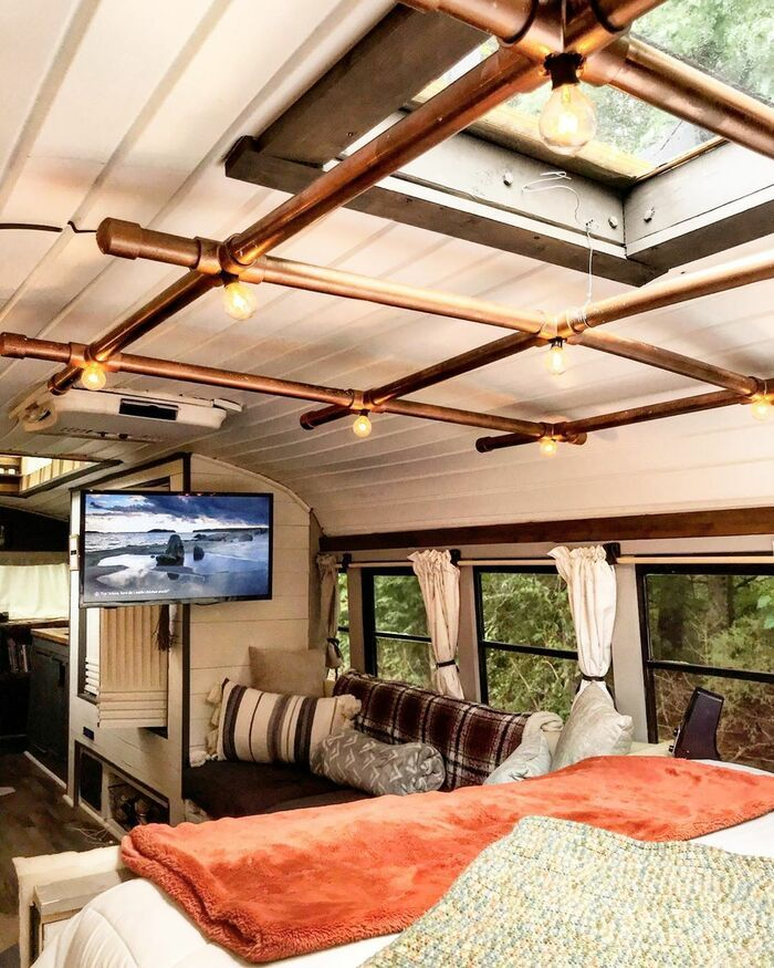 skoolie bedroom - Caleb and friends converted old school bus into a lovely mobile home on $10K budget