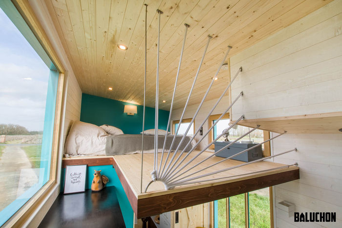 tiny house baluchon 4 - Colorful tiny house boasts staircase with built-in dog nook and sitting area