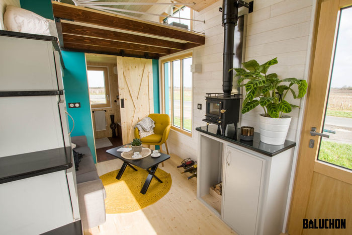 tiny house baluchon 5 - Colorful tiny house boasts staircase with built-in dog nook and sitting area