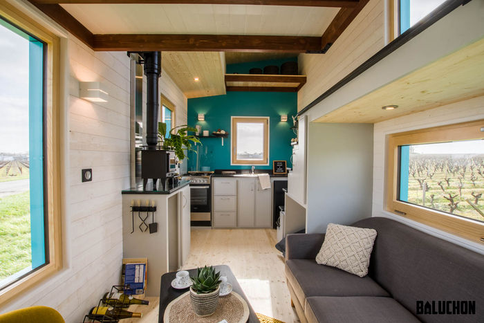 tiny house baluchon 7 - Colorful tiny house boasts staircase with built-in dog nook and sitting area