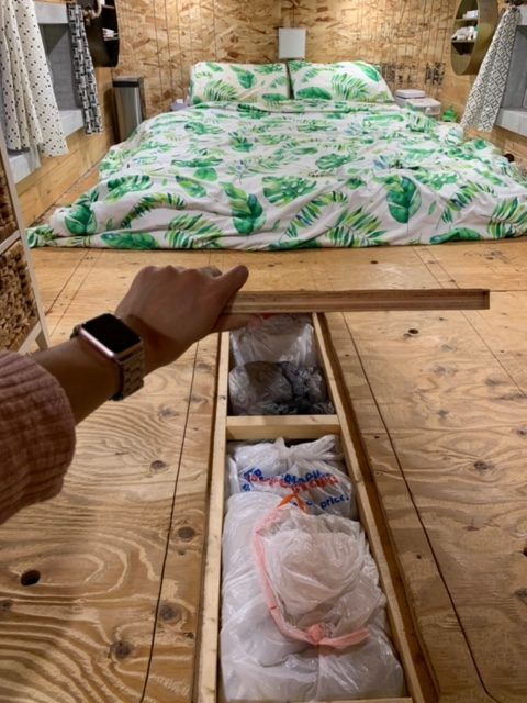 tiny house bedroom 1 rotated - This spectacular tiny house exudes rustic charm. And it's for sale right now
