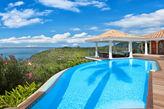 HAPPY BAY VILLA...  wonderful 4BR villa w/ full AC, heated pool!