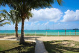 BEACHSIDE CONDO... You can't get much closer to the beach than this!!