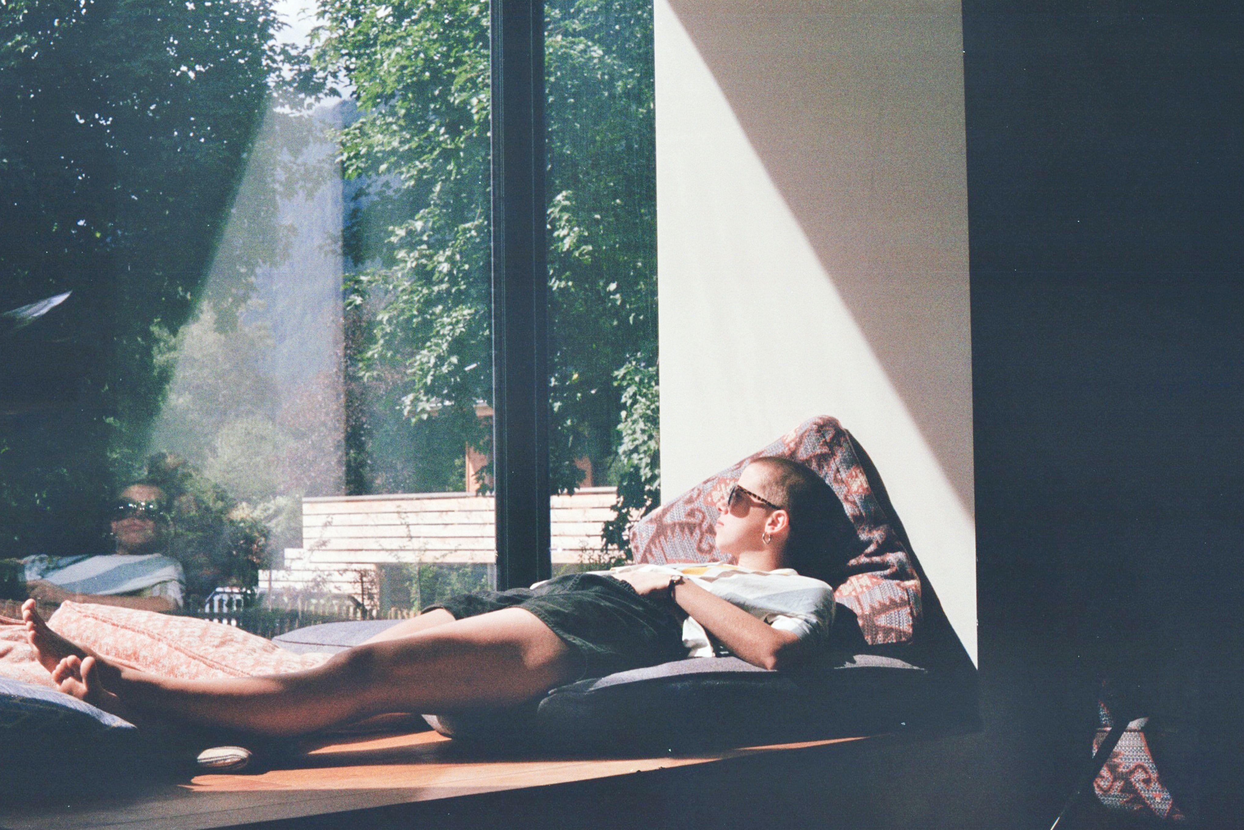 Man reflecting by windowsill