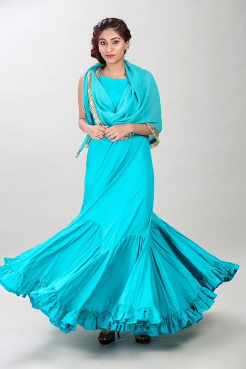 Gown with tasseled scarf