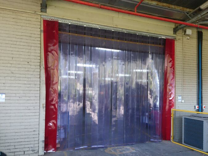 Static installation of clear vinyl curtains industrial